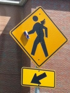 Crosswalk sign with energy drink.
